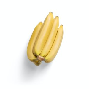 3 yellow banana fruits on white surface